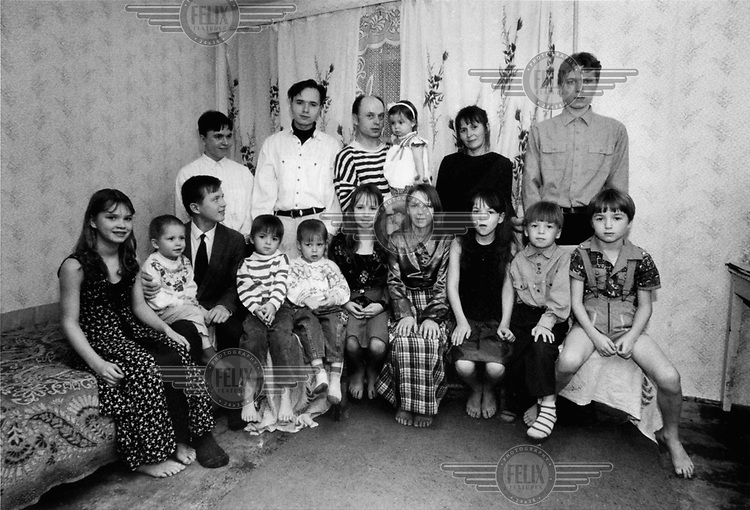 Heldur Netocny / Panos Pictures..Upper Volga, RUSSIA..Nina and Vladimir Alexejev and their 14 children in Kostroma. The family lives on welfare and NGO handouts.