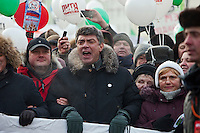 Moscow, Russia, 04/02/2012..Opposition politician Boris Nemtsov shouts slogans as tens of thousands of demonstrators march in central Moscow and protest against election fraud and Prime Minister Vladimir Putin in temperatures of -20 centigrade. Organisers claimed an attendance of 130,000 despite the bitter cold.