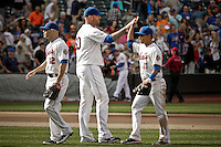 New York Mets relief pitcher Jon Rauch ( C) celebrates the end of the game with his teammates against Miami Marlins at Citi Field Stadium in New York. Photo by Eduardo Munoz Alvarez / VIEW.