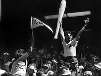 FANS: Oakland Athletics fan waving pennant at standing New York Yankee fan. At the Oakland-Alameda County Coliseum during the Oakland A's vs. the Yankee's 1978 photo/Ron Riesterer