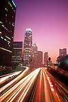 Rush hour downtown LA with car light streaks along Harbor freeway, Los Angeles, California USA.