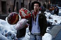 A man carries globes for his girlfriend during Valentine's Day in New York, Feb 14, 2014. VIEWpress/Eduardo Munoz Alvarez