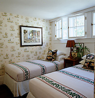 Vintage wallpaper covers the walls of this guest bedroom