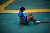 The Indian Kabbadi team-member relaxes after a game at a month long camp in Sport Authority of India Sports Complex in Bisankhedi, outskirts of Bhopal, Madhya Pradesh, India.