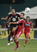 WASHINGTON, DC. - AUGUST 22, 2012:  Dwayne DeRosario (7) of DC United is held by  Daniel Paladini (11) of the Chicago Fire during an MLS match at RFK Stadium, in Washington DC,  on August 22. United won 4-2.