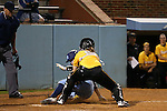 CHAPEL HILL, NC - FEBRUARY 24: UNC's Kendra Lynch (behind) beats the tag by Towson's Holiday Cahill (in yellow) and scores the game-winning and game ending run in the bottom of the ninth inning. The University of North Carolina Tar Heels played the Towson University Tigers on February, 24, 2017, at Anderson Softball Stadium in Chapel Hill, NC in a Division I College Softball match. UNC won the game 6-5 in nine innings.