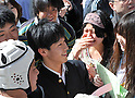 March 10, 2011, Tokyo, Japan - A test-taker in high school uniform is welcomed by senior students of Tokyo University as the results of its second phase entrance examinations are posted on the Hongo campus in Tokyo on Thursday, March 10, 2011. A total of 3009 applicants passed the exams to be enrolled by the nationÅfs most prestigious institution. (Photo by Natsuki Sakai/AFLO) [3615] -mis-