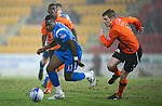 St Johnstone v Dundee United....22.02.11 .Cleveland Taylor turns Paul Dixon.Picture by Graeme Hart..Copyright Perthshire Picture Agency.Tel: 01738 623350  Mobile: 07990 594431