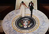 Washington, DC - January 20, 2009 -- United States President Barack Obama walk to dance with First Lady Michelle Obama at the Commander-In-Chief's Inaugural Ball January 20, 2009 in Washington, DC.  Obama was sworn in as the 44th President of the United States, becoming the first African American to be elected President of the U.S.  .Credit: Mark Wilson - Pool via CNP