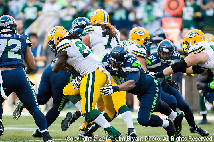 Seattle Seahawks defensive tackle Kevin Williams (94)  attempts to tackle Green Bay Packers running back Eddie Lacy (27) in the NFL Kickoff Game game at CenturyLink Field in Seattle, Washington on September 4, 2014.  Seattle beat Green Bay 36-16. ©2014  Jim Bryant Photo. ALL RIGHTS RESERVED.