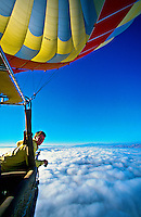 Hot air balloon pilot Lars-Eric More of Kapadokya Balloons looks out above the clouds over Cappadocia, Turkey