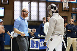 11 February 2017: UNC's Theophilus Onigbinde (right) talks with coach Will Randolph (left) during Saber. The Duke University Blue Devils hosted the University of North Carolina Tar Heels at Card Gym in Durham, North Carolina in a 2017 College Men's Fencing match. Duke won the dual match 19-8 overall, 6-3 Foil, 6-3 Epee, and 7-2 Saber.