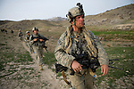 Private Dan Burris of the 82nd Airborne patrols for Taliban in a remote mountain region of Kandahar province, Afghanistan on Monday, March 26, 2007.