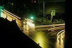 Late night street scene with traffic trough intersection downtown Seattle car light streaks Washington State USA