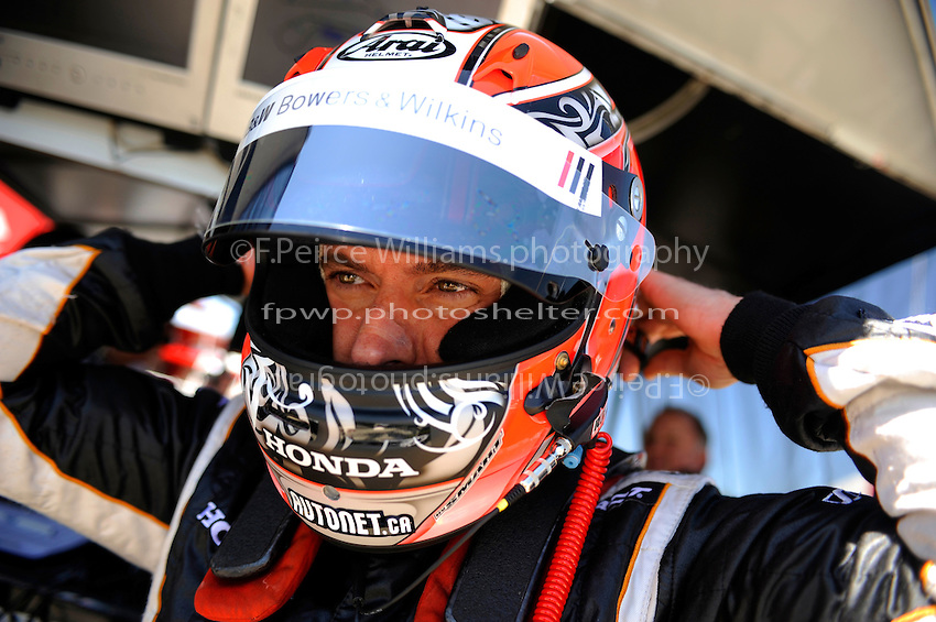 Alex Tagliani (#77) straps on his helmet.