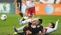 D.C. United forward Lionard Pajoy (26) goes against New York Red Bulls defender Heath Pearce (3)  The New York Red Bulls tied D.C. United 1-1 in the first leg of the Eastern Conference semifinals at RFK Stadium, Saturday November 3, 2012.
