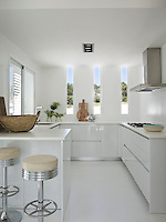 The small all white kitchen is ergonomically designed and very functional