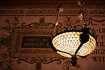 A detail of a mosaic wall and lamp in the Chicago Cultural Center.