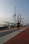 Penn's Landing, man jogging in front of historic ship, mod rel..Philadelphia, Pennsylvania, PA USA.  Photo copyright Lee Foster, 510-549-2202, lee@fostertravel.com, www.fostertravel.com. Photo 238-30391