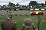 Goodwood Festival of Speed. Goodwood Sussex. Men in their hunting tweeds, they hav forgotten to bring ear defenders.