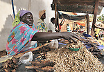 Christine Ataya sells dried shrimp in the market in Yei, Southern Sudan, supported by a microfinance program run by the United Methodist Women in Yei.