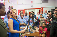 NY City Council Speaker Melissa Mark-Viverto surrounded by City Council members and participants in the Summer Youth Employment Program (SYEP) announces the first day of the program at the CAMBA food pantry and hydroponics farm in Brooklyn in New York on Monday, July 7, 2014. The competitive program adds over 10,600 job slots to SYEP providing paid employment for up to six weeks in July and August.