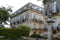 General view of Casas Gemelas (Twin Houses), early 20th century, Paseo Montejo,  Merida, Yucatan, Mexico, pictured on July 18, 2006, in the evening. These twin mansions, with French Renaissance features, were designed by French architect Gustave Umbdenstock (1866-1940), and Manuel Canton Ramos, who also oversaw the building of the Palacio Canton, supervised their construction. One of the houses was decorated in the early 20th century style by Fernando Barbachano, and has been preserved. Merida is the state capital of Yucatan. Picture by Manuel Cohen.