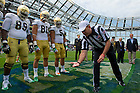 Sept. 1, 2012; Notre Dame football players watch during the coin toss against Navy in the 2012 Emerald Isle Classic at Aviva Stadium in Dublin, Ireland. Photo by Barbara Johnston/University of Notre Dame