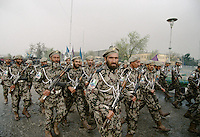 Soldiers of warlord Ahmad Shah Massoud arm with Kalashnikov, on the road to the military parade, for the celebration of the Kabul liberation from the communist.