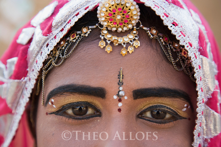Rajasthani dancer wearing make-up and traditional jewelry, close-up of eyes, Thar Desert, Rajasthan, India --- Model Released