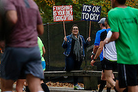 A woman holds a posters as she cheers to the runners during the annual TCS New York City Marathon in Central Park New York 01.11.2015. Mary Keitany wins second consecutive NYC Marathon, Stanley Biwott is men's winner. Ken Betancur/VIEWpress.