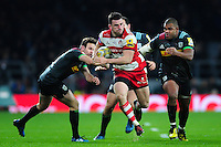 Matt Scott of Gloucester Rugby takes on the Harlequins defence. Aviva Premiership match, between Harlequins and Gloucester Rugby on December 27, 2016 at Twickenham Stadium in London, England. Photo by: Patrick Khachfe / JMP