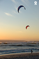 Two kite surfers on beach at sunset (Licence this image exclusively with Getty: http://www.gettyimages.com/detail/sb10068805ac-001 )