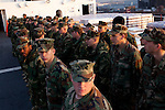 Sailors deployed from Portsmouth, Virginia, on board the USNS Comfort, a naval hospital ship, before it gets under way to Haiti to assist earthquake victims on Saturday, January 16, 2010 in Baltimore, MD.