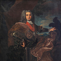 Portrait of King John V or Joao V, 1689-1750, known as John the Magnanimous or Joao o Magnanimo and the Portuguese Sun King or Rei-Sol Portugues, in the Great Room of Acts, or Sala dos Capelos, or Red Room, decorated in the 17th century by master builder Antonio Tavares and reworked in the 18th century, at the University of Coimbra in the royal palace or Paco Real, Coimbra, Portugal. The University of Coimbra was first founded in 1290 and moved to Coimbra in 1308 and to the royal palace in 1537. The buildings are listed as a historic monument and a UNESCO World Heritage Site. Picture by Manuel Cohen