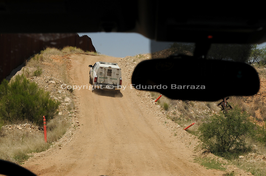 Sasabe, Arizona – A Border Patrol vehicle rides ahead of a convoy of journalists who head to a remote area near Sasabe, Arizona. The image was taken from another Border Patrol vehicle. U.S. Customs Border Protection (CBP) transported journalists to this remote area where they walked through a 1.3 miles trail during a two-day event organized by the Tucson Sector Border Patrol. The event brought national and international journalists to the Arizona desert to become acquainted with the dynamics of this area. This area is located near the Sasabe Port of Entry, a border-crossing station located in southern Arizona, and about 70 miles from the City of Tucson. Sasabe is one of the most isolated ports along the 2,000-mile U.S.-Mexico border, and it connects the towns of Sasabe, Arizona and El Sasabe, Sonora (Mexico). The border-crossing station is located in one of the busiest human and drug smuggling corridors of the U.S.-Mexico border. Photo by Eduardo Barraza © 2012