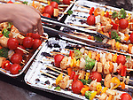 Closeup of vegetarian skewers with vegetables and tofu cooking on fire
