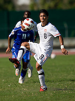 Esteban Rodriguez (8) of the United States concentrates on his first touch during the quarterfinals of the CONCACAF Men's Under 17 Championship at Catherine Hall Stadium in Montego Bay, Jamaica. The USA defeated El Salvador, 3-2, in overtime.