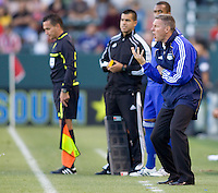 Kansas City Wizards head coach Peter Vermes yells out directions to his players. The Kansas City Wizards defeated CD Chivas USA 2-0 at Home Depot Center stadium in Carson, California on Sunday September 19, 2010.