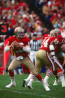 SAN FRANCISCO, CA - Quarterback Joe Montana of the San Francisco 49ers in action during a game at Candlestick Park in San Francisco, California in 1990. Photo by Brad Mangin