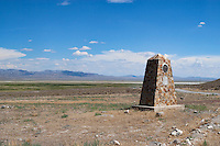 An obelisk marks the location of the Fish Springs Pony Express Station in Utah's Great Salt Lake Desert. The route followed by the Pony Express near Fish Springs was later used as part of the Lincoln Highway, the first transcontinental auto road, starting in 1913. The Civilian Conservation Corps (CCC) erected numerous markers in 1939 and 1940 to mark the location of Pony Express stations. Photographed 07/07