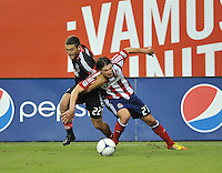 D.C. United defender Chris Korb (22) goes against Chivas USA defender Ben Zemanski (21)  D.C. United defeated Chivas USA 1-0 at RFK Stadium, Sunday September 23, 2012.