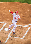 1 April 2013: Washington Nationals outfielder Bryce Harper crosses the plate after hitting his first home run of the game, opening the scoring 1-0 against the visiting Miami Marlins on Opening Day at Nationals Park in Washington, DC. The Nationals shut out the Marlins 2-0 to launch the 2013 season. Mandatory Credit: Ed Wolfstein Photo *** RAW (NEF) Image File Available ***