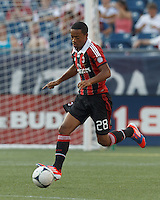 AC Milan substitute midfielder Urby Emanuelson (28) brings the ball forward. In an international friendly, AC Milan defeated C.D. Olimpia, 3-1, at Gillette Stadium on August 4, 2012.