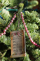Christmas ornaments hanging on a Christmas tree
