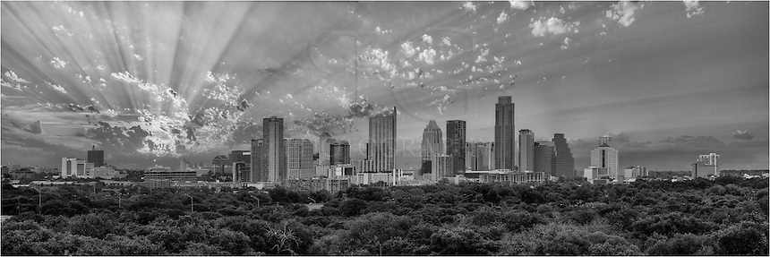 his image captured one of those fortuitous moments. Taken from a parking garage along Mopac, the sun broke through the clouds and bathed the Austin in rays of light.