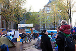 Occupy Amsterdam demonstration outside the Amsterdam Stock Exchange at Beursplein, Amsterdam, the Netherlands. This is one of many 'occupy' protests fallowing the Occupy Wall Street protests in New York, against economic inequality. October 19th 2011. Copyright 2011 Dave Walsh, davewalshphoto.com