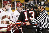 Jimmy Hayes (BC - 10), Tommy Cross (BC - 4), Randy Guzior (Northeastern - 13), Chris Aughe - The Boston College Eagles defeated the Northeastern University Huskies 5-4 in their Hockey East Semi-Final on Friday, March 18, 2011, at TD Garden in Boston, Massachusetts.