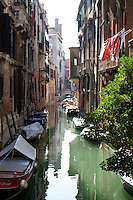 A canal with gondolas in Venice, Italy. October 2010.