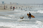 Surfers surfer surf Surfing surfboard Huntington Beach California. Photograph by Alan Mahood.